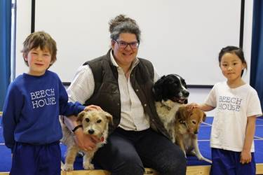 Victoria and her dogs with Year 2 pupils Freddie and Chloe