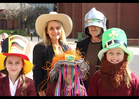 Mrs Marsden and Head Mrs Brierley show off their hats with the Hesketh House girls