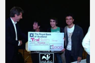 Sixth Form Boys Collect Cheque from Eco Dragons