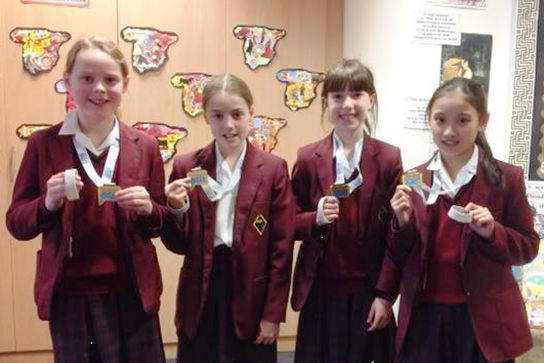 The Junior Girls' Swimming Team with their gold medals