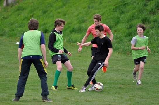 Boys' Division pupils playing football with their French counterparts