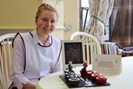 Bake Off winner Issy with her Showstopper 100/500 cupcakes