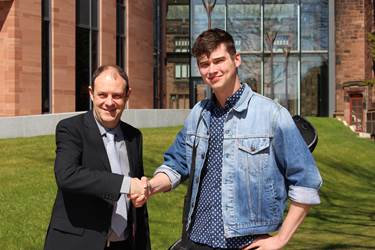 Jordan Allen is welcomed back to the School by Mr Bleasdale, Head of Music in the Boys' Division