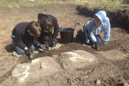 Some of the boys excavating part of an old farm building wall