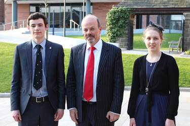 Martin Birchall is welcomed to the School by Alex Farrell and Elizabeth Cummings