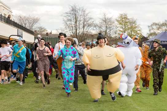 A sumo wrestler takes an early lead shortly after the start line