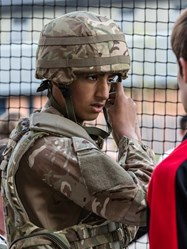 A boy dons a helmet during the Equipment Command Task
