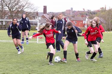 The Bolton School girls (in red) played some impressive football