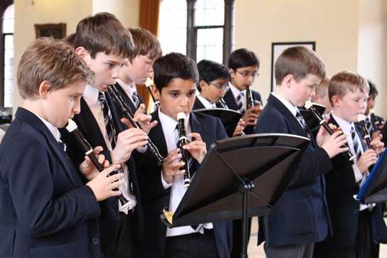 Boys on recorder playing pop hit 'Uptown Funk'