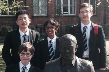 Alex, Eddy, Krishnan and Matthew with the statue of Alan Turing at the University of Manchester