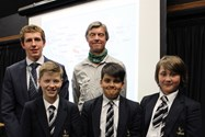 Mr Brooker (centre) with Mr Teasdale and three pupils who attended the talk