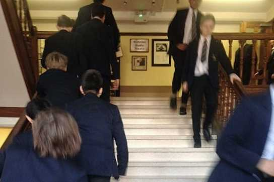 Boys climbing the height of Everest on the School's stairs, raising money to aid Nepal