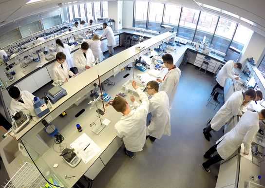 The teams at work in UCLan's laboratories