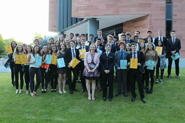 Old Girl Jeanette McCormick celebrates with the Sixth Form students their exceptional commitment to volunteering over the course of the academic year