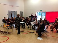 Miss Clare Deady conducts the Joint Junior Orchestra