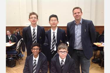 The boys pictured with their Maths teacher, Mr Neil Holmes