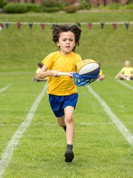 "A competitor in the ""egg and spoon"" race at Beech House Sports"