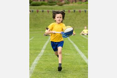 "A competitor in the ""egg and spoon"" race at Beech House Sports' Day"