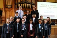 Alan Gibbons, Rebecca Stevens and Rohan Gavin with pupils from Bolton School, Philips High School and St James