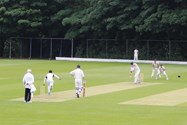 The Bolton School team bowling against the MCC side