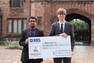 Year 12 pupils Samee Malik and Sam Gorick with the cheque for Barnardo