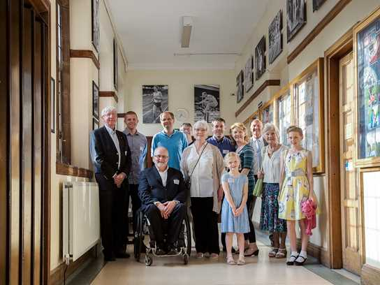 John Boulter, David McCulloch, Sir Philip Craven and the Goudge and Whittle families are pictured with Headmaster Philip Britton
