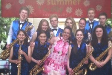 The Saxophone Choir and Miss Berry at the Luxembourg bandstand where they performed