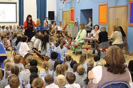 Mrs Procter and Lulu the Teddy lead the assembly