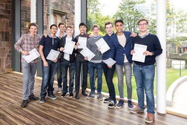 10 and 11 A* boys celebrate their GCSE results