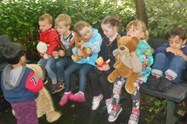The children had lots of fun having their picnic in the woods
