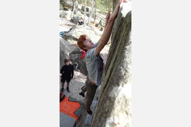 Ben bouldering with Bolton School