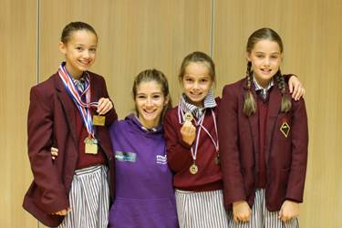 Sian with some of the Junior Girls' School young athletes