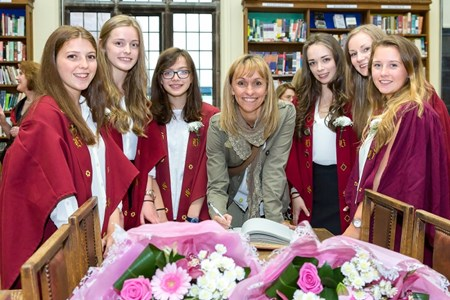 The Head Girl and her deputies welcome Michaela to the School