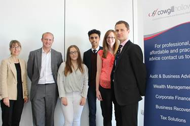 Claire Jewsbury and Rob Lord of Cowgill Holloway are welcomed to the School by Sixth Form students and teachers