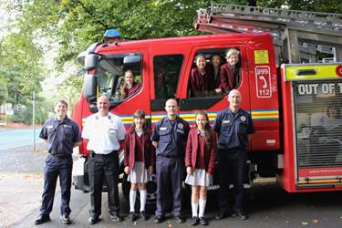 The girls with the visiting firefighters and fire engine