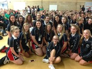 The girls and teaching staff pose for a photograph with Sally Gunnell