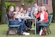 Alumni enjoyed the good weather, reminiscing outside the Arts Centre and in the Headmaster