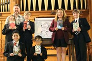 Pupils holding the nominated book with Curtis Jobling and a sketch he drew on the occasion
