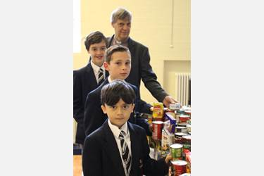 The Reverend Petch and Junior Boys make their donation to Winter Watch