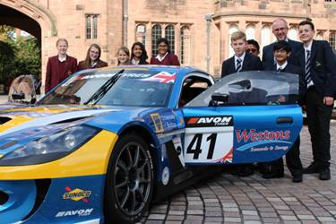 Pupils with one of the University of Bolton's race cars