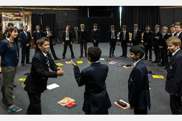Boys 'pass a clap' around the circle as a warmup exercise