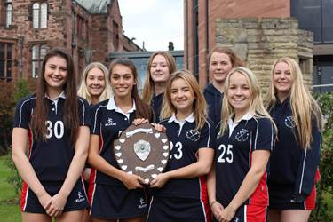 The U16 team with their trophy