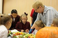 Mrs Riley talks to the girls about an array of unusual fruits