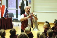 Stewart playing a genuine Tudor cornett for the pupils