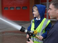 Having a go with the hose at the Fire Station
