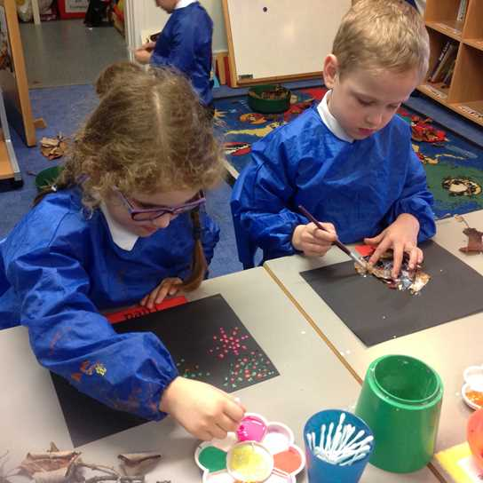 Pupils work on their Bonfire Night celebration artwork