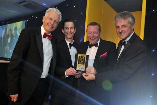 John Newbould, Head of Marketing at Bolton School hands over the Young Business of the Year Award to ZEAL Creative