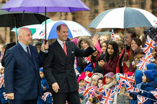 Prince Edward was warmly greeted by Bolton School pupils waving Union Jack flags