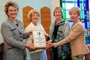Henrietta, the Duchess of Bedford, presents the award to Speakeasy representatives Stephanie Holland and Jean White, and to Gill Pearl (far right)