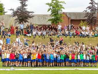 Children and parents celebrate the end of a fantastic Sports Day